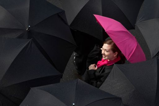 Insurtech Insights - lady holding pink umbrella