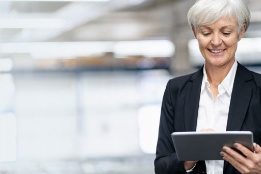 Lady in a suit holding a tablet