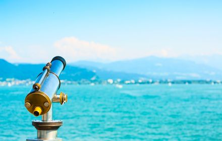 Blue mountains and sea with focus on telescope