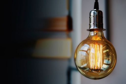 What can UK home service providers learn from their peers across the Pond - Lightbulb wood plank