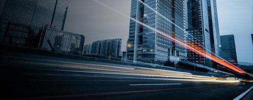 long exposure light trails on road glass buildings
