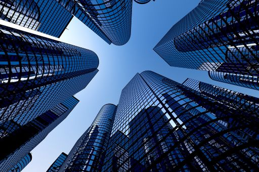 Low angle view of glass buildings with clear sky