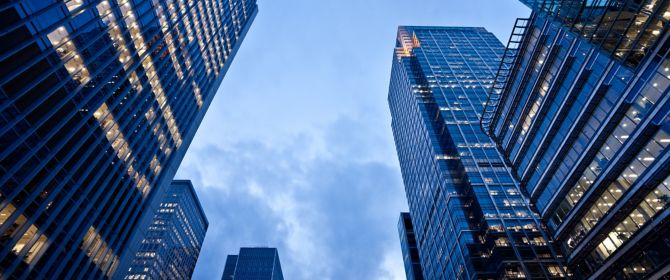 Lower view of skyscrapers buildings at Canary Wharf at evening