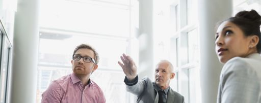 Man explaining to two people