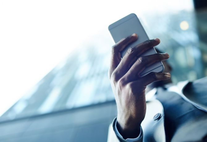 Man holding mobile phone in hand