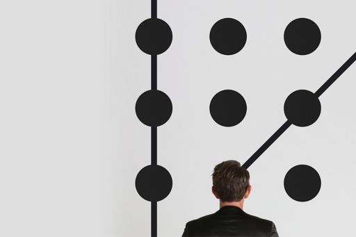Man standing in front of black circles