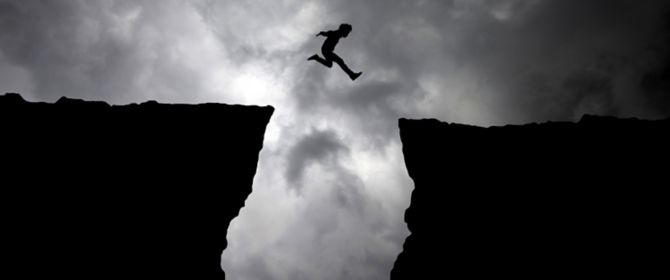 Man jumping from cliff