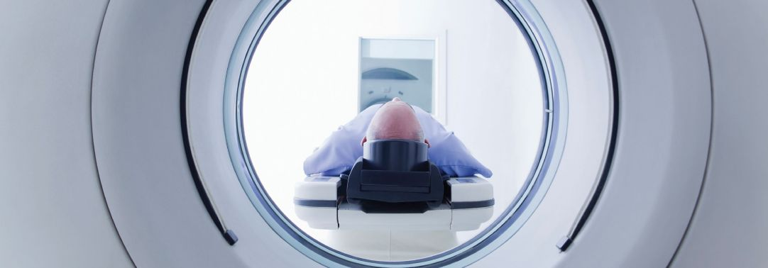 Man lying inside the scanning machine