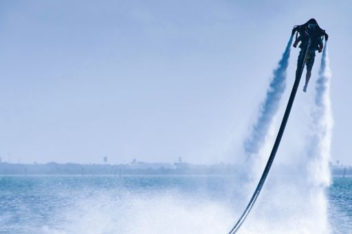 Man on flyboard on water