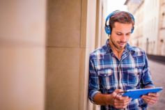 Managing risk and unlocking the value of innovation - Man on headphones