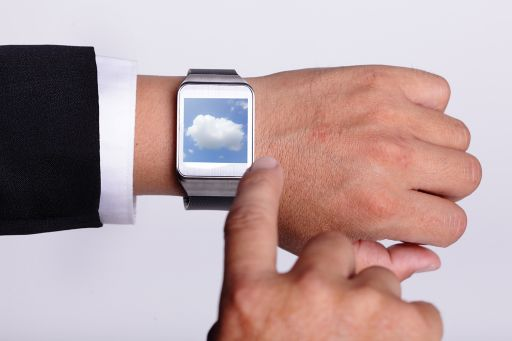 man pointing at smartwatch