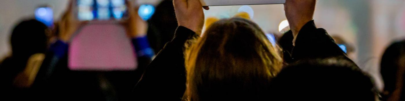 Man recording fireworks with tablet