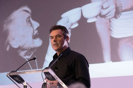 Man speaking over the micrphone while giving presentation