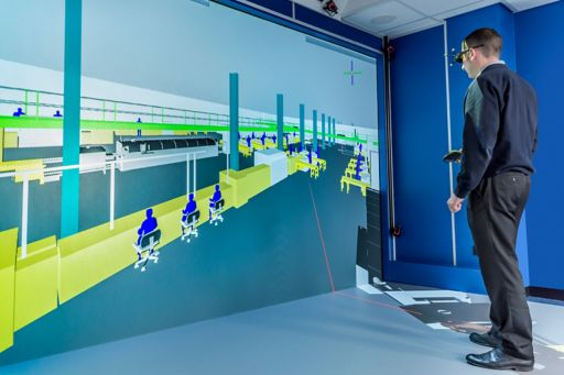 Man standing in front of office animated wall