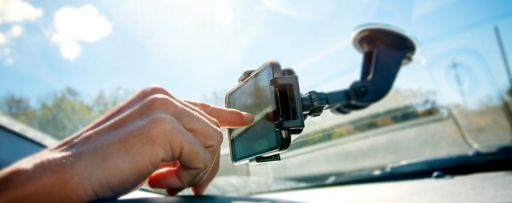 Person using GPS on car windscreen