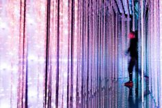 Man walking through light streams