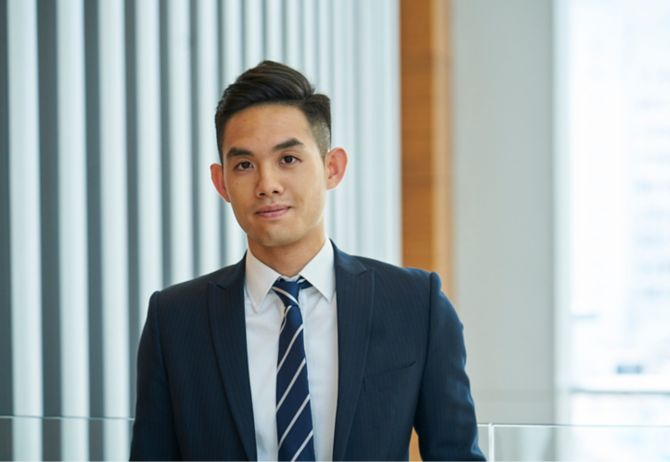 Man wearing formal suit with blue tie
