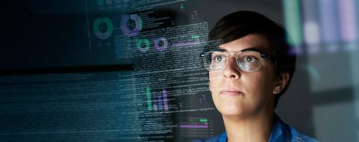 Person wearing spectacles looking at screen