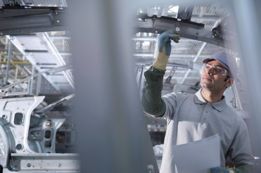 Man working on automotive production line