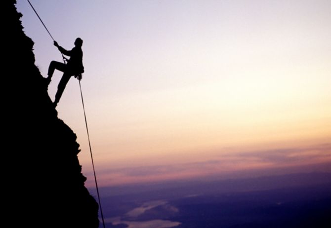 Mountain climber in the evening