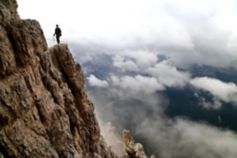 Mountain climber on the side of cliff