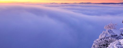 mountain view of a sea of clouds at sunset