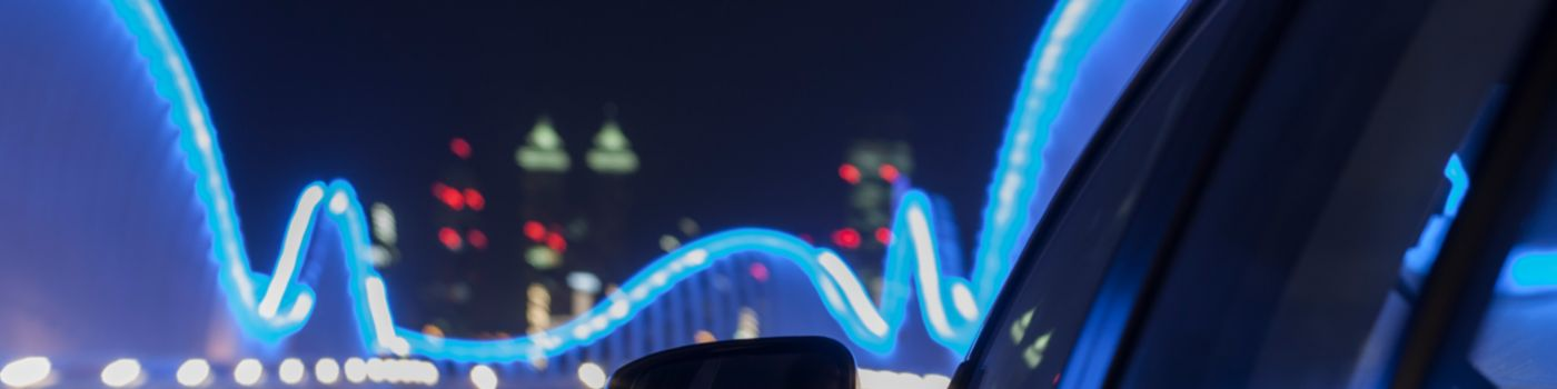 Moving car on a bridge with blue lights at night