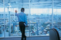 businessman looking out of office