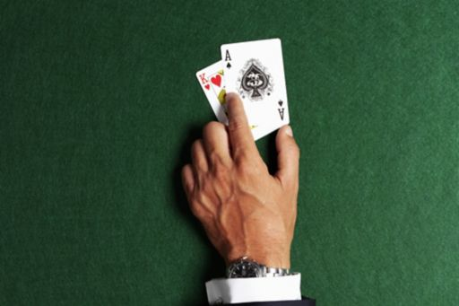 hand with game cards