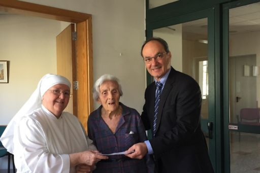 Presenting donation to home
