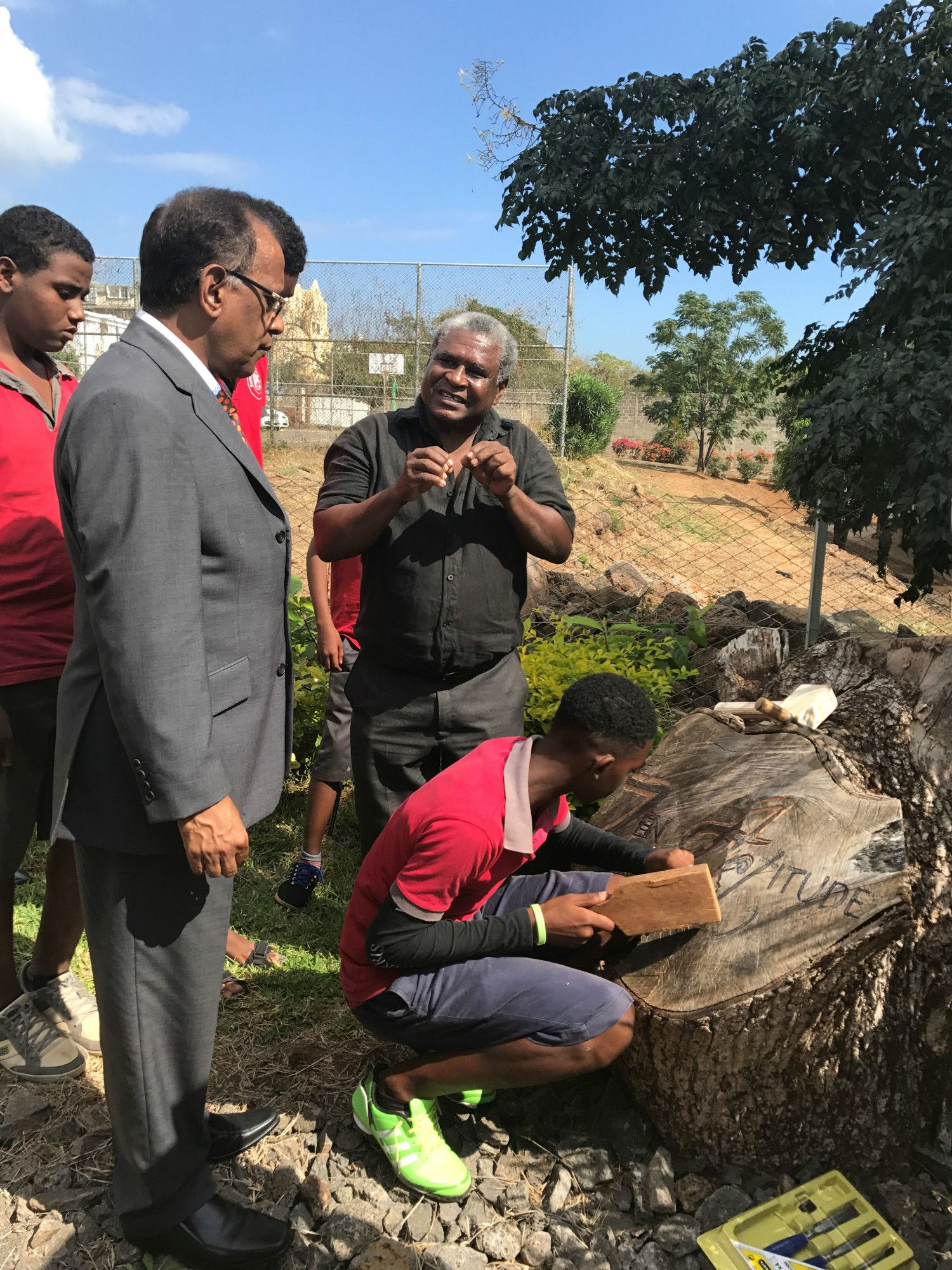 Live engraving of the Zen Artitude Boutik logo on wood by the students to commemorate the event, in the presence of Hon. Soomilduth Sunil Bholah (Minister of Business, Enterprise and Cooperatives)