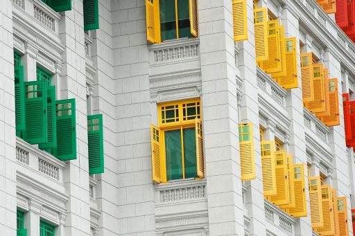 Building exterior with colourful window blinds
