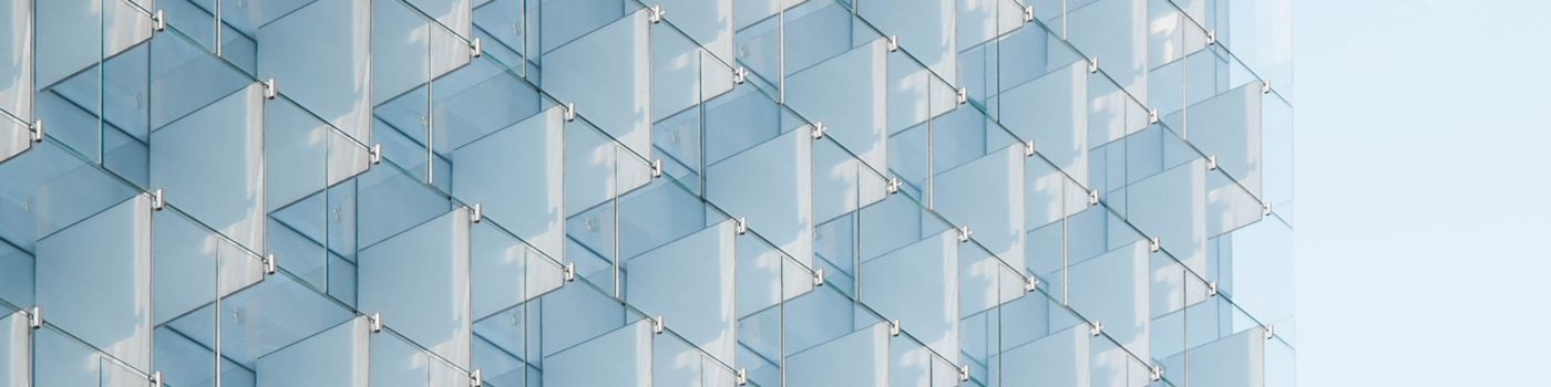 multiple glass doors reflection in blue glass building