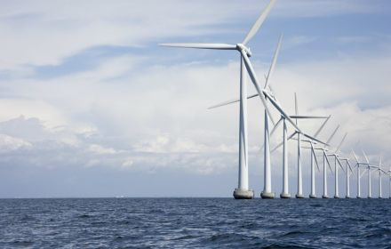 A row of windmills in sea