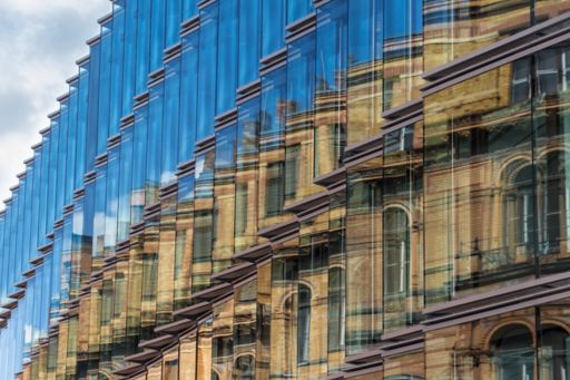 Reflection of old building in a new facade