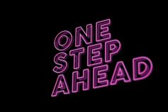 'One step ahead' written in pink neon writing on a black background