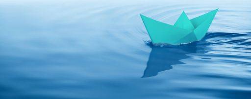 Origami boat floating on water