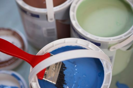 paintbrush in paint can
