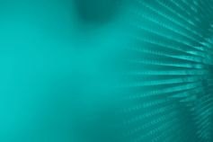 Pattern of spiral waves converging at corner with cyan shade
