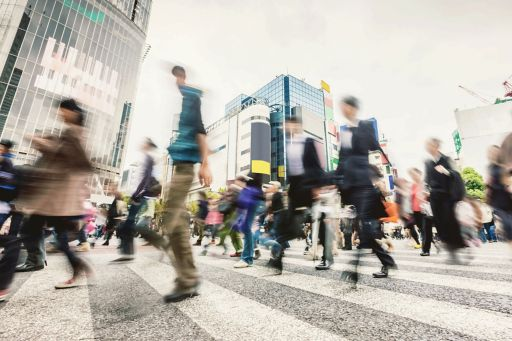 Blurred image of pedestrians at a zebra crossing