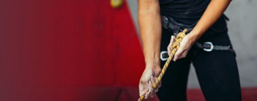 woman holding climbing rope