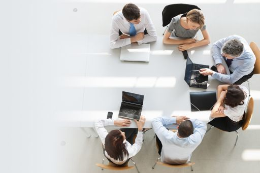 people-sitting-round-a-table-in-a-meeting