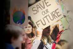 people-protesting-with-save-our-future-earth-burning-placards