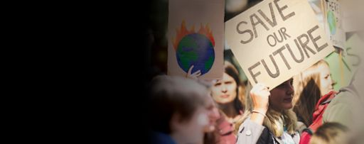People protesting with save our future earth burning placards