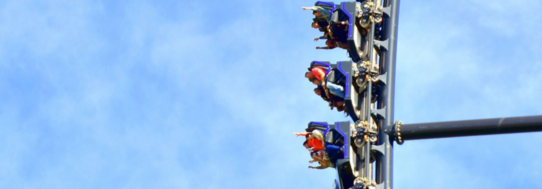 People sitting in rollercoaster ride