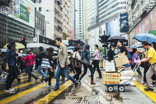 People waling on the busy street