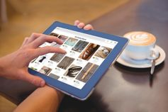 person doing online shopping on their tablet