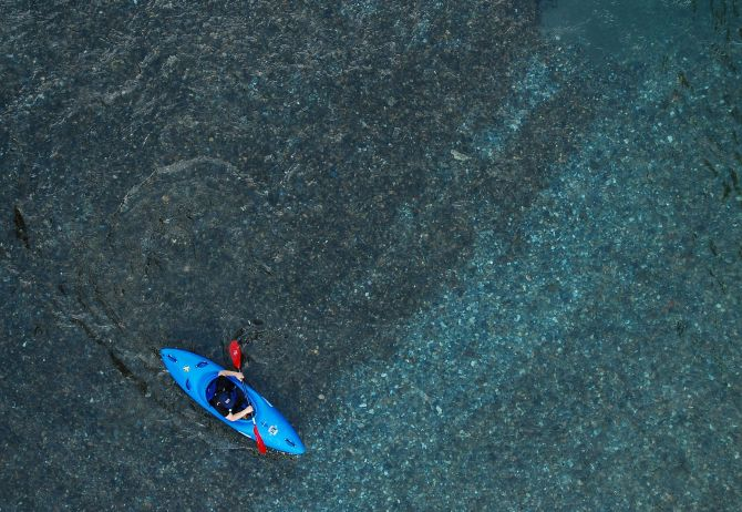 Person on blue rowing boat