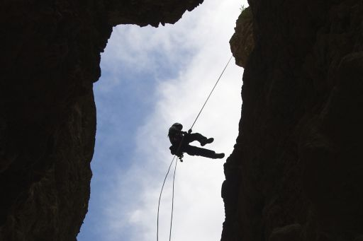 person-repelling-off-cliff