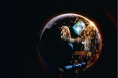 Person working in a bubble against black background